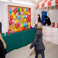 8. Ballon Pop Wall with Darts